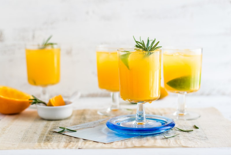 A glass of orange juice on a table