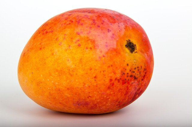 A close up of an apple and an orange